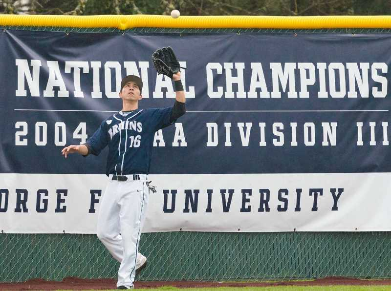 PHOTO COURTESY OF GFU - Zachary Muenster hauls in a fly ball on the warning track Sunday during George Fox's 5-3 home loss to Whitworth.