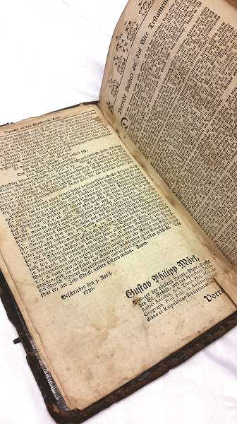 JOHN BAKER - Stored in an old locked cupboard, the book has been hidden for years before its accidental discovery. The Bible has been donated to the Mt. Angel Abbey for its historical significance. Interestingly, in the book's index, the first four books of the Bible are listed not only in German, but in English.