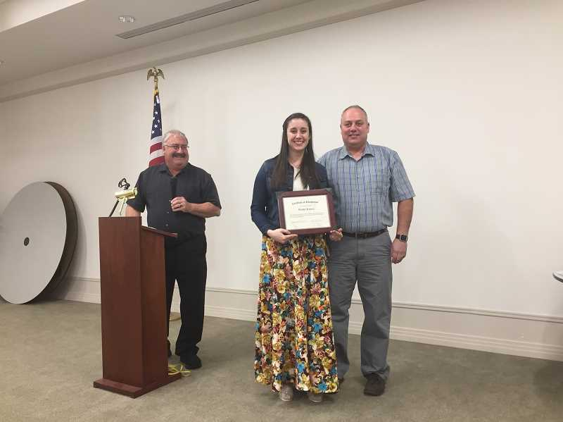 COURTESY PHOTO: AURORA FIRE DISTRICT - Awards included the Five Years of Service Award given to firefighter/EMT Alisha Kuenzi (center). She is flanked by Chief Rod Yoder (left) and Operations Chief Greg Dyke, who also was honored with a 30 Years of Service Award.