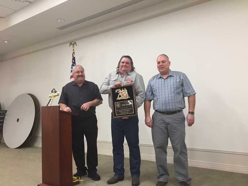 COURTESY PHOTO: AURORA FIRE DISTRICT - Awards included the 35 Years of Service Award given to Capt. Dan Yoder (center). He is flanked by Chief Rod Yoder (left) and Operations Chief Greg Dyke, who also was honored with a 30 Years of Service Award.