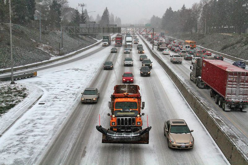PORTLAND TRIBUNE FILE PHOTOS - The Oregon Department of Transportation struggled to keep freeway traffic moving during the winter storms.