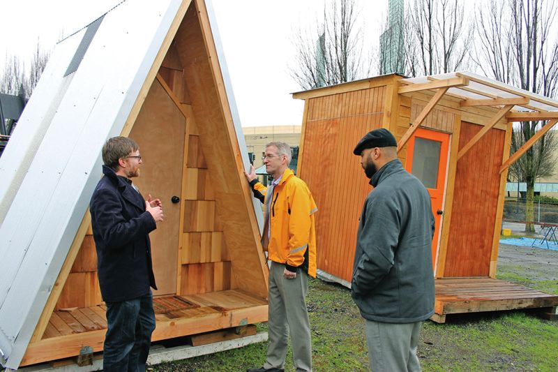 PAMPLIN MEDIA GROUP: LYNDSEY HEWITT - Mayor Ted Wheeler checked out the Kenton neighborhoods tiny home village earlier this month.
