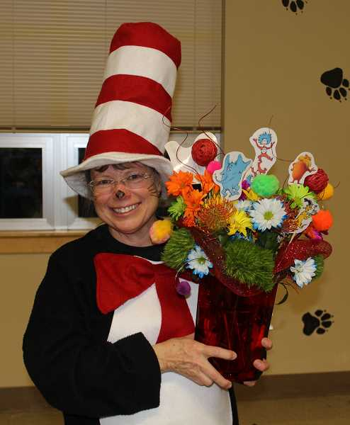 SUBMITTED PHOTO - Cindy Dix, dressed as the Cat in the Hat,  was thanked with a bouquet for her years of organizing the event in Culver.