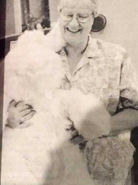 ARCHIVE PHOTO - In 1987, Estacada Community Center director Louise Mahlum posed with a giant stuffed bunny, an auction prize to support operations at the center.