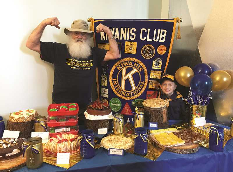 Charlie Williams, left, with a Cub Scout at the Blue and Gold dessert auction table