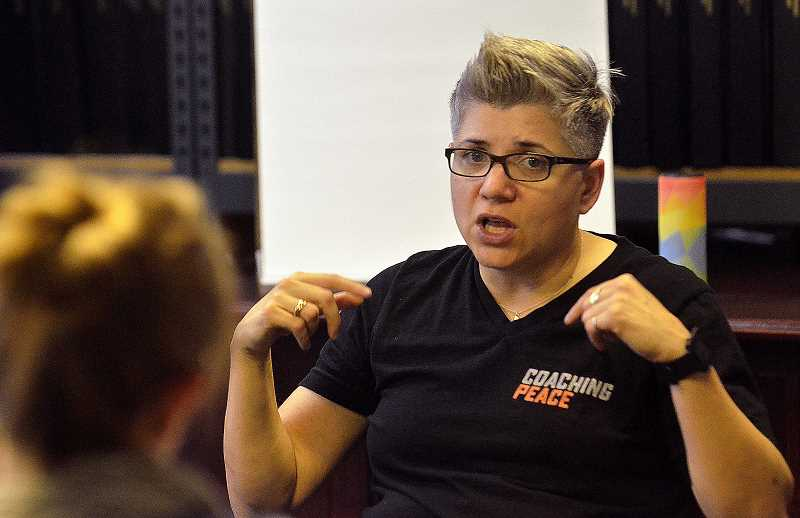 REVIEW FILE PHOTO: VERN UYETAKE - Diana Cutaia is the president of Coaching Peace Consulting, and she said one of the core problems with online culture is anonymity.