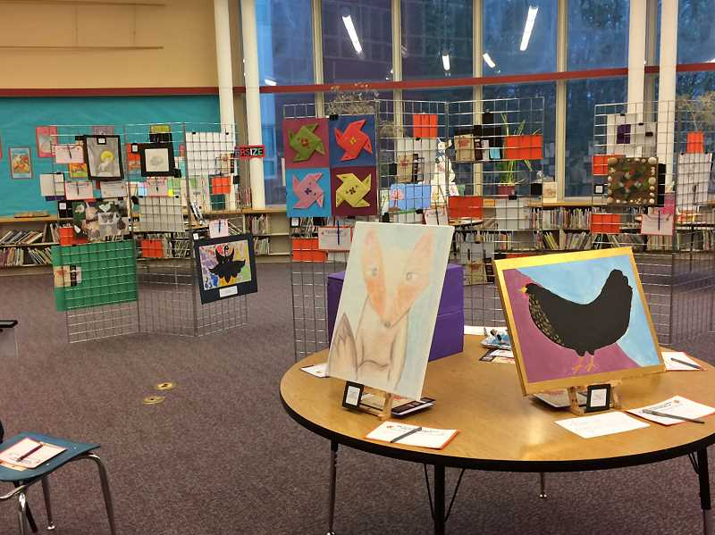 SUBMITTED PHOTO: MOLLY DUCKER - A student art gallery in the library was part of the Evening of STEAM at Oak Creek Elementary.