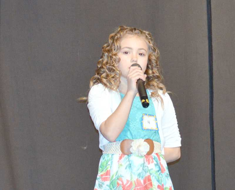 PIONEER PHOTO: CINDY FAMA - Anastaysja Pewitt sings 'See You Again' by Wiz Khalifa at the eighthannual Stars on Stage fundraiser