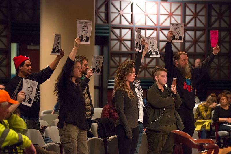 PORTLAND TRIBUNE: JONATHAN HOUSE - Protesters expessed their displease with the council's vote at the end of the meeting.