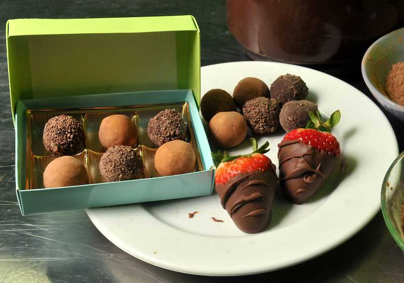 STAFF PHOTO: VERN UYETAKE - Golden specializes in handmade chocolate truffles with flavors such as raspberry, lemon, caramel, peanut butter and espresso.
