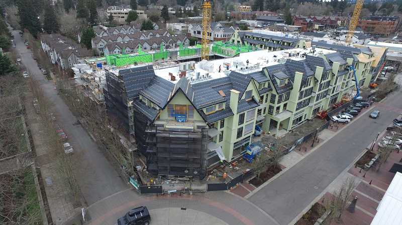 REVIEW PHOTO: ALVARO FONTAN - March 10, 2017: Building C along First Street feels the most complete at this point. Inside, crews are already framing walls and working on laying out the where the lights, sprinklers and grilles will eventually be located. Even the building's elevator is now being installed.