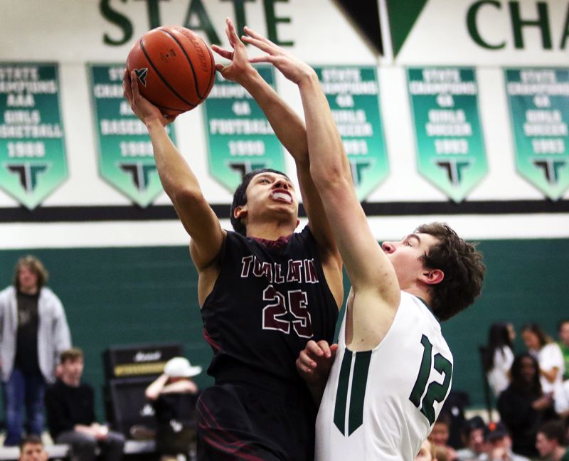 DAN BROOD - Tualatin junior Alexis Angeles (left) was named the Three Rivers League boys basketball Player of the Year.