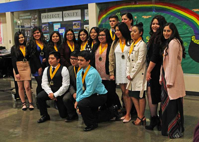 INDEPENDENT PHOTO: JULIA COMNES - Seal of Biliteracy recipients were honored with medals at a recognition ceremony on March 14. In total, 64 Woodburn students were recognized. Seal of Biliteracy recipients from WAAST are pictured after receiving their medals.