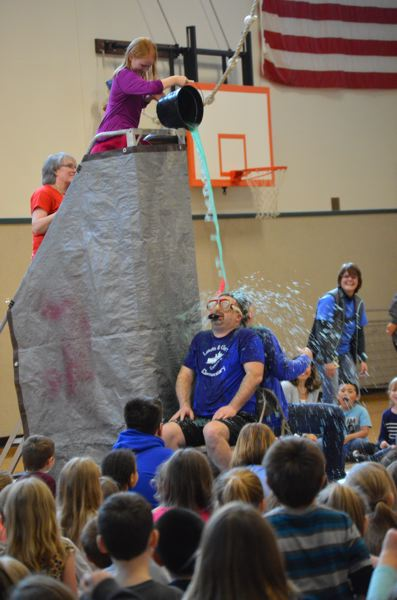 SPOTLIGHT PHOTO: NICOLE THILL - Dustin Salisbury and Mike Scott get 'slimed' during a school assembly on Friday, March 10.