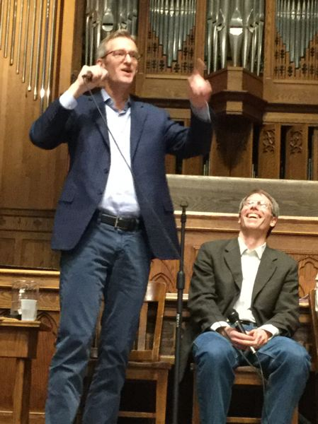 TRIBUNE PHOTO: STEVE LAW - Mayor Ted Wheeler at Thursday's 'Let's Talk Climate' town hall. On the right is Michael Armstrong, deputy director of the Bureau of Planning and Sustainability.