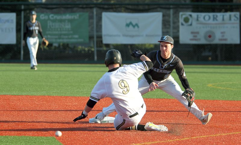 PMG PHOTO: MILES VANCE - Lakeridge second baseman Clint Smith tries to corral a throw as Jesuit's John Arndorfer steals second base during the Crusaders' 3-0 home win on Thursday.