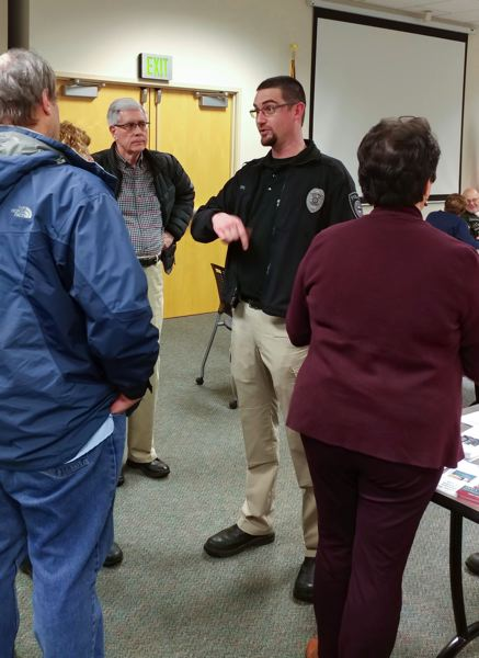 OUTLOOK PHOTO - During a reception hosted by the Coalition of Gresham Neighborhood Associations, community members thanked officers like Dan Estes, center, for their work.