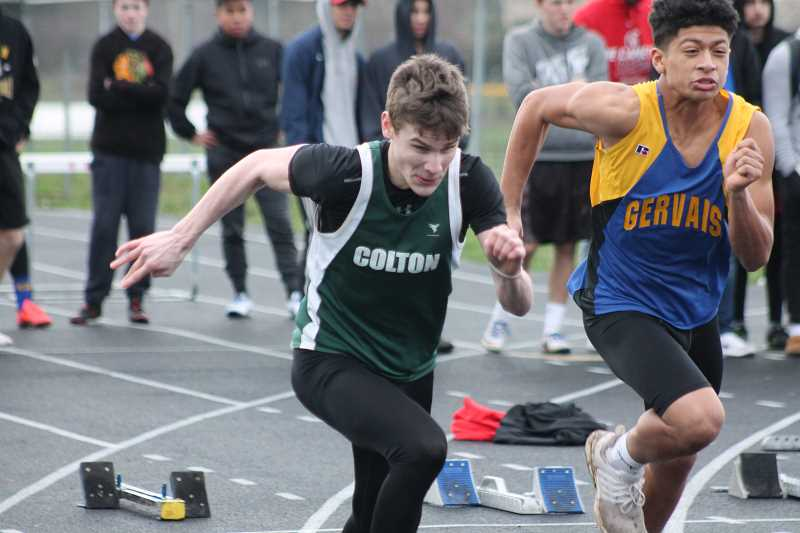 PIONEER PHOTO: CONNER WILLIAMS  - Colton junior Evan Rasor rockets out of his block in the 100 Meter spring during the Kennedy Icebreaker track meet on Wednesday. Rasor took second in the event by less than .20 seconds.