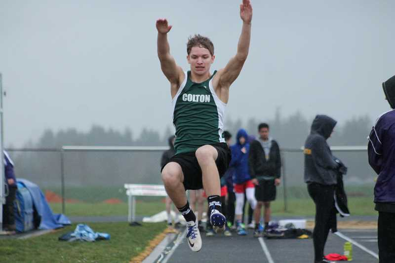 PIONEER PHOTO: CONNER WILLIAMS  - Colton freshman Wyatt Earls competes in the Long Jump during the Kennedy Icebreaker track meet on Wednesday. He finished sixth in the event.