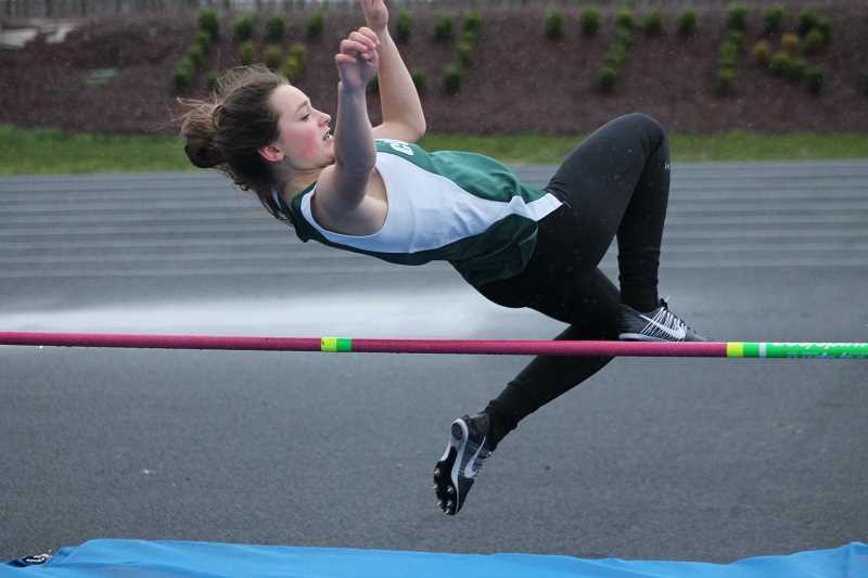 PIONEER PHOTO: CONNER WILLIAMS  - Colton freshman Mya Fulmer competes in the High Jump during the Kennedy Icebreaker track meet on Wednesday. She took T-fourth in the event as she completed 4-00.