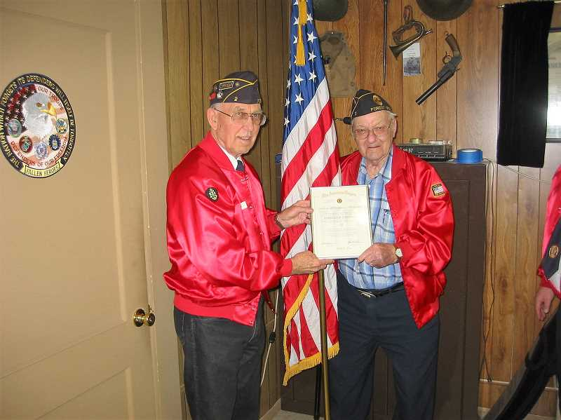 SUBMITTED PHOTO - Harold Johnson (right) gets longtime membership award.