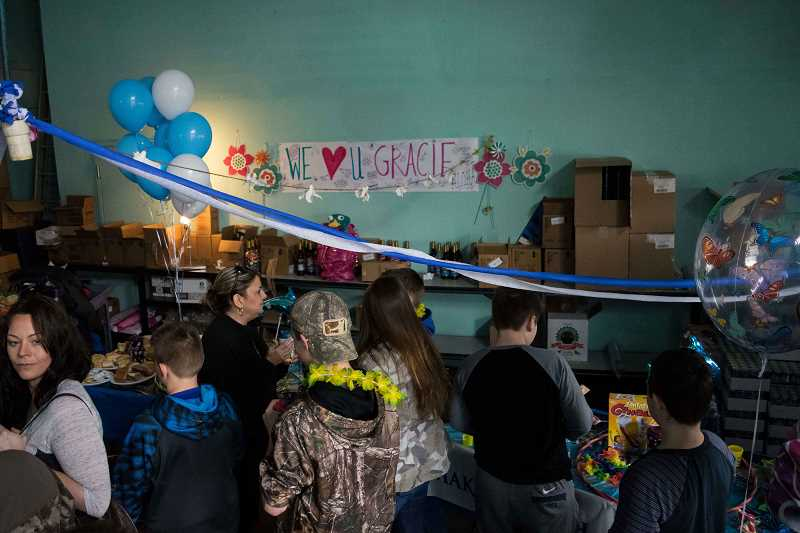 NEWS-TIMES PHOTO: TANNER BOYLE - The event included treats and balloons inside the Dutch Bros. garage.