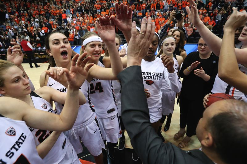 TRIBUNE PHOTO: JAIME VALDEZ - The Oregon State Beavers women's basketball team gives a final cheer at Gill Coliseum after its second-round win over Creighton in the NCAA Tournament on Sunday night.