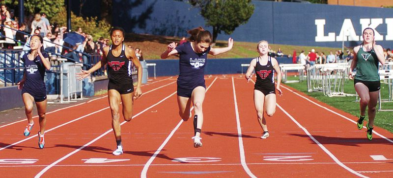 PMG FILE PHOTO - Lake Oswego sophomore Maddie DeBord (lane 3) should once again be among the Three Rivers League's best sprinters after winning a district title in the 100 meters in 2016.