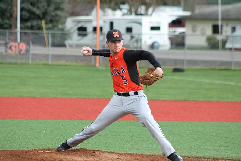 PIONEER PHOTO: CONNER WILLIAMS - Molalla senior Aaron Alexander started on the mound for the Indians during their 8-6 win over Silverton on March 18 at Scio High School. Alexander only allowed one run in his five innings pitched.