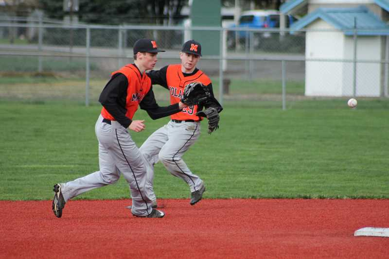 PIONEER PHOTO: CONNER WILLIAMS - Molala sophomore Jeff Larsen makes a play at shortstop as senior Trevor Miles backs him up from second during the Indians' 8-6 win over Silverton on March 18 at Scio High School.