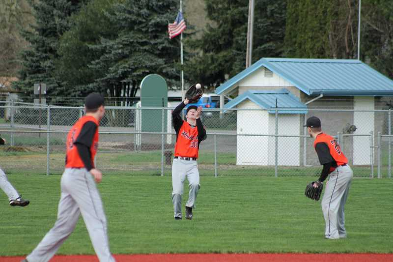 PIONEER PHOTO: CONNER WILLIAMS - Molalla junior Hunter Dublin makes a catch in shallow right field during the Indians' 8-6 win over Silverton on March 18 at Scio High School.