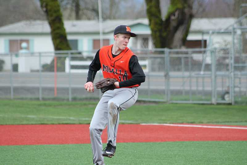 PIONEER PHOTO: CONNER WILLIAMS - Molalla junior Matt Roark wings up for a pitch in the top of the seventh as he looks to get the save during the Indians' 8-6 win over Silverton on March 18 at Scio High School.