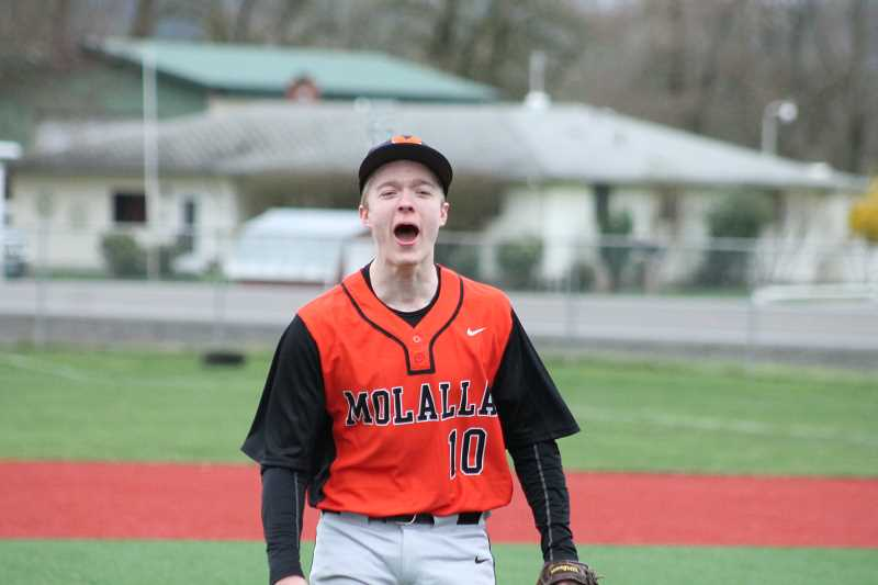 PIONEER PHOTO: CONNER WILLIAMS - Molalla junior Matt Roak cheers after clinching the save for the Indians.