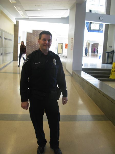 PHOTO BY: RAYMOND RENDLEMAN - David Plummer, an OCPD school resource officer, often can be seen patroling the halls at Oregon City High School.