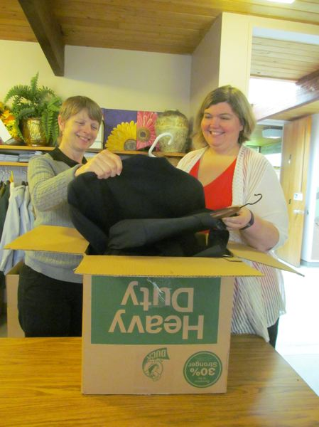 PHOTO BY ELLEN SPITALERI - Patti Jay, left, and Rev. Becca Wieringa, pastor at St. Paul's United Methodist Church, sort through clothing donated to the Veterans and Families Resource Center of Oregon.