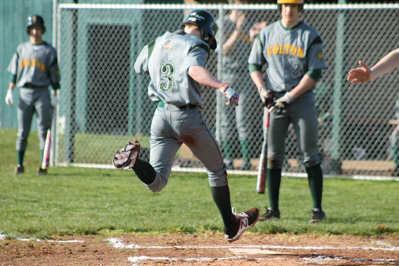 PIONEER PHOTO: CONNER WILLIAMS  - Colton sophomore TJ Tiano scores the first run during the Vikings' 10-4 loss to Vernonia last week in their season opener.