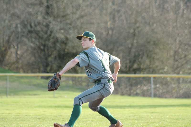 PIONEER PHOTO: CONNER WILLIAMS  - Colton junior Dawson Hall winds up for a pitch during the Vikings' 10-4 loss to Vernonia last week in their season opener.