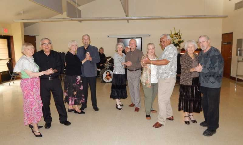 REGAL COURIER PHOTO: BARBARA SHERMAN - Dancers having fun at a recent Marjorie Stewart Community/Senior Center weekly dance are (from left) Patricia Billings taking a spin with band member Larry Burnett; Brigitte and Rolf Hoehna; Denise and Richard Lenc; Charlyne and George Binabese; and Delpha Reiboldt and Ron Bonneau.