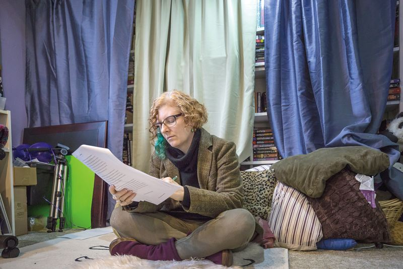 TRIBUNE PHOTO: JONATHAN HOUSE - PSU researcher Dora Raymaker edits an article at her home office in Northeast Portland.