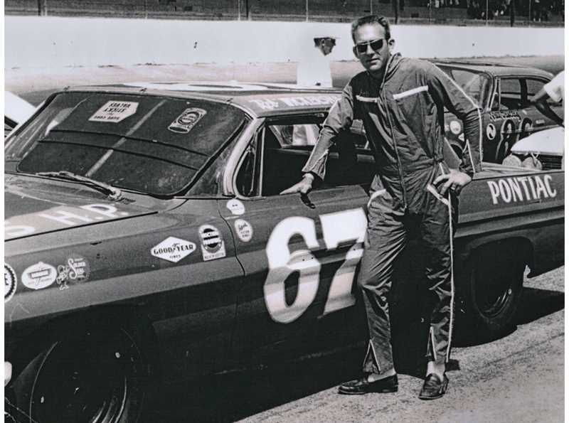 PHOTO COURTESY OF REB WICKERSHAM - Former NASCAR driver Charles 'Reb' Wickersham stands next to his 1962 Pontiac at the Rebel 300 on May 11, 1963, at Darlington Raceway in South Carolina. Wickersham placed 23rd in the event, one of 41 NASCAR races in which he competed between 1960-1965.