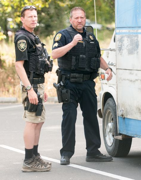 FILE PHOTO: JOSH KULLA - Sheriff's Deputy Kent Krumpschmidt, left, assists Sgt. Rodney Wilkerson in checking out a suspicious vehicle at the Sandy River Delta State Park in this 2015 file photo.