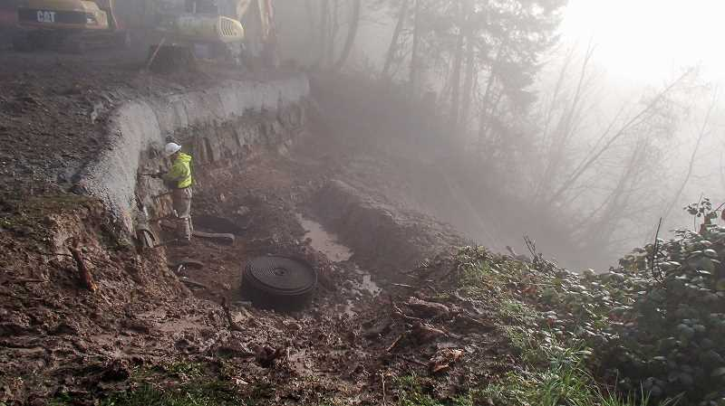 CONTRIBUTED PHOTO - Contractors work to stabilize the hillside between Southeast 232nd Drive and Southeast Tong Road on Highway 224 that has been closed because of landslides. ODOT officials said they hope to have the section reopened during the first week of April.