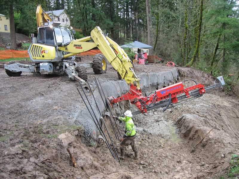 CONTRIBUTED PHOTO - A new drainage system and soil nails are part of a solution to stabalize the 70-foot hillside on a section of Highway 224.