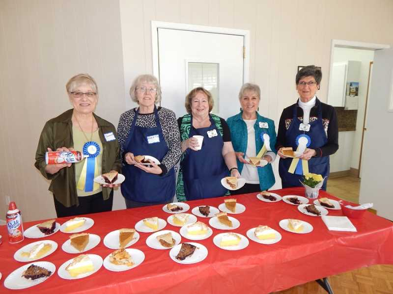 REGAL COURIER PHOTO: BARBARA SHERMAN - (From left) KCCA residents Suzanne Whisler, Marietta Davis, Peggy Trees, Carolyn Griffith and Nancy Hayes, who all worked on the Pies of March, stand by a tableful of pie slices ready for the next guests through the door.