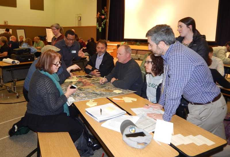 REGAL COURIER PHOTO: BARBARA SHERMAN - At the UGB community meeting held March 13 at Deer Creek Elementary, area residents expressed a variety of opinions about future development, while King City Mayor Ken Gibson (at head of table) answered questions at one of the tables.