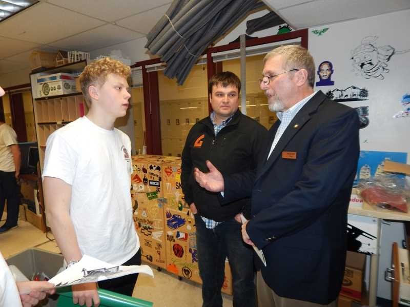 REGAL COURIER PHOTO: BARBARA SHERMAN - At a Sherwood High School Career Technical Education event Jan. 25, Rep. Rich Vial (right) with his son Nic Vial (center), talks to a student about hi future career plans.