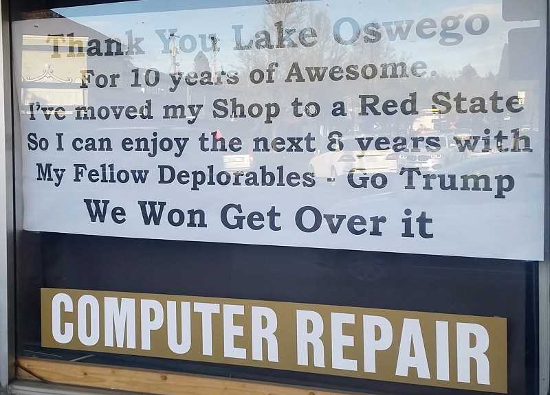 REVIEW PHOTO - A sign in the window of Kevin 'The Geek' Kerwin's computer repair store announces his intention to leave Lake Oswego and set up shop in a 'Red State.'