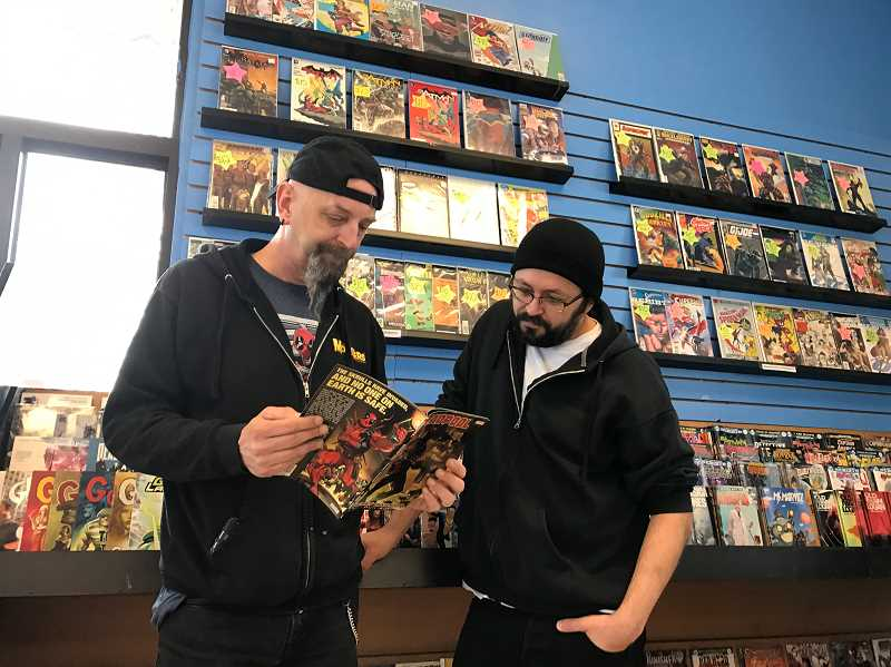 HILLSBORO TRIBUNE PHOTO: GEOFF PURSINGER - Mark Newman, left, and Charlie Foran recently opened The Longbox on Cornelius Pass Road. Hillsboros only comicbook shop, the store specializes in buying and selling older comics, as well as new releases.