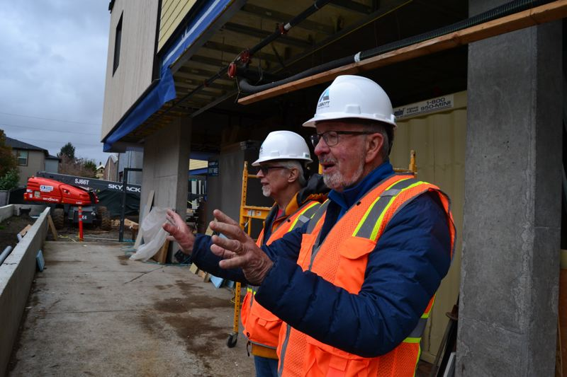 PAMPLIN MEDIA GROUP: JULES ROGERS - Project co-founders Jim Swenson and Lew Bowers point out what will go into their shared condo cohousing.