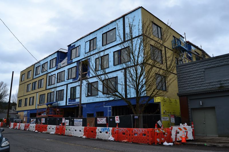 PAMPLIN MEDIA GROUP: JULES ROGERS - Siding is being installed on the cohousing project now, which will also include solar panels, a rooftop garden, a commercial kitchen and large interior common areas.